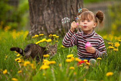 girl-blowing-bubbles-with-cat